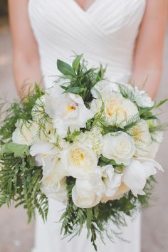 Elegant white and green wedding bouquet - orchids, garden roses, lisianthus, and greenery {Abbey Lunt Photography}
