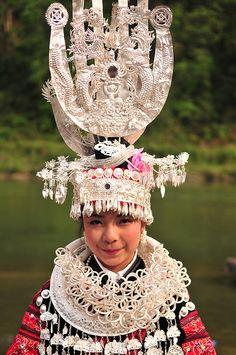A Miao woman in China in festival dress * 1500 free paper dolls at international artist Arielle Gabriels The International Paper Doll Society also free Chinese paper dolls The China Adventures of Arielle Gabriel *