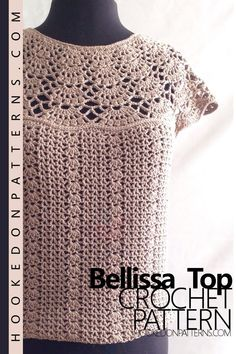Bellissa Tucked Hem Top Crochet Pattern from Hooked On Patterns. A gorgeous blouse with lacy, floral shell, yoke design. The open yoke top is complemented by a looser fitting, textured, body and elasticated hem. A perfect addition to your summer wardrobe, for both casual day or elegant evening wear. Available for sizes from Small up to 3XL Plus Sizes. #crochet #clothing #fashion #pattern