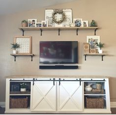 Barn door entertainment center.  Similar concept for entertainment center, but either taller or full wall.