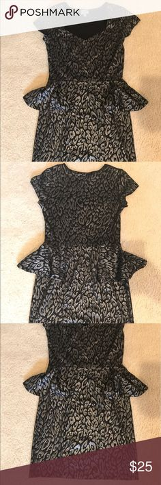 ❤️Classy and flattering peplum dress!Size small❤️ Silver and black peplum dress. Super flattering to figure. Black with shiny silver detail. Very comfortable and form fitting! Brand is Paris LA. ( Not BCBG. Tagged for exposure). Worn once. No defects. BCBG Dresses Mini