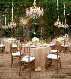 these blush sequin tableclothes and low-hanging chandeliers are perfect accents to this stunning #garden #wedding #reception