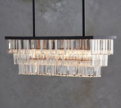 Clear faceted crystals in our Gemma Collection give a contemporary look to a classic design. They hang from smooth bronze-finished bands in our Gemma Rectangle Chandelier. Place it over a dining table, in an entryway or bedroom for lighting that s… Rectangular Chandelier, Dining Chandelier, Crystal Chandelier Lighting, Dining Room Light Fixtures, Chandelier Bedroom, Chandelier Ceiling Lights, Dining Room Lighting, Room Lights, Chandeliers