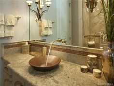 Powder room - vessel sink - tile work - blue and stone.  Perfect accessorizing for a powder room.  Port Royal | Naples, Florida
