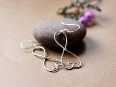 Infinity Heart Earrings by Tangle on Etsy   FREE Sterling Silver Heart Stud Earrings with any purchase of $20 or more from tangle.etsy.com between now and February 14th, 2016. Spread the love this Valentine's Day with an extra something special!