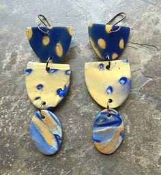 Polymer clay earrings by Linda. Brooks