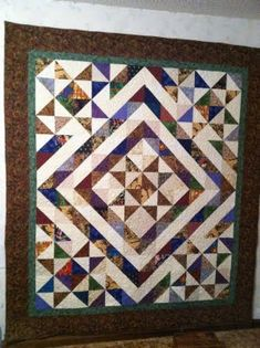 A very effective quilt, using 6 1/2 inch squares of scraps. Somehow I think there are an abundance of those at my house.