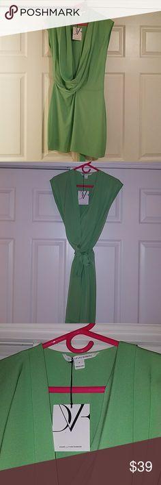 Diane Von Furstenberg green silk dress New with tags. Melon green silk. Drapes in front. Self belt optional. Above the knee. Beautiful. Diane von Furstenberg Dresses Midi