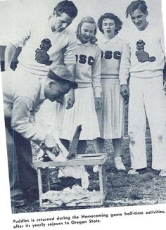 Puddles is returned to Oregon unharmed by Oregon State's rally squad. From the 1948 Oregana (University of Oregon yearbook). www.CampusAttic.com