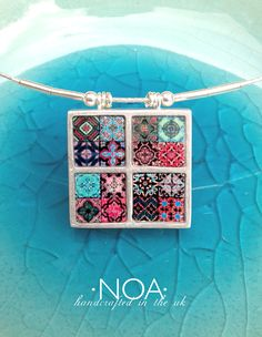 NOA Jewellery Aluminium and ceramics 4 square window necklace, multi colour. www.noajewellery.com