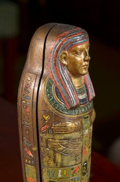 "Cold Painted Austrian Bronze Sculpture by Franz Bergman modeled as an Egyptian sarcophagus with a hinged lid that opens to reveal a nude girl signed ""Nam Greb"" (Bergman backwards)    SOLD"