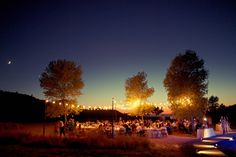 love the fairy lights at this rustic wedding reception under the stars