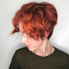 Copper red wavy crop pixie cut by Aveda Artist Robert Sparrow.