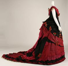 Ball gown                                                                            Date:                     late 1870s                                          Culture:                     British                                          Medium:                     silk                                          Dimensions:                     [no dimensions available]                                          Credit Line:                     Gift of Mary Pierrepont Beckwith, 1969