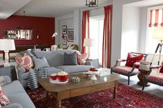 Ok, I'm tearing off what I've started upholstering my two armchairs in, and I'm going to find something similar to the red/white print on these two armchairs.  I love it!
