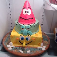 Sponge Bob chocolate and vanilla cakes filled with chocolate chip cream . All iced in buttercream icing with fondant  embellishments. Shells are made from white chocolate.