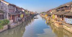 Xitang --- An ancient scenic town in Jiashan County, Zhejiang Province, China. Its history dates back to at least the Spring and Autumn Period (771 until 476 BC)  when it was located at the border of the State of Yue and Wu.  Xitang is a water town crisscrossed by nine rivers. The town stretches across eight sections, linked by old-fashioned stone bridges.