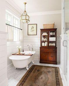 This weekend sales picks are up on Beckiowens.com! Freestanding tub, vintage rug, shiplap + Morris lantern combo is Bathroom via @countrylivingmag