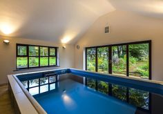 An indoor Endless Pools® swimming machine, installed by John Preston Pool & Spa.   With large windows on all sides, the picturesque scenery outside pops against the simple, yet well finished decor allowing for a thoroughly enjoyable swim.