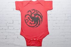 Game of Thrones Baby, House Targaryen Bodysuit/Creeper  Show your support for House Targaryen with this outfit. Design showing the House Targaryen dragon sigil. A wonderful baby shower gift for the book nerd, fantasy lovers!  Bodysuit is screen printed with eco friendly water based ink, and is made from 100% cotton.  A great gift for the Game of Thrones fan!  Care Instructions: Machine wash cold, tumble dry low.