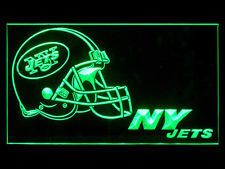 """New York Jets Electric Light • Click on image for awesome view. Solid state technology Simply plug it in and behold a beautiful lighted glowing sign for displaying in your window, Man Cave, Dorm, Bar, Home, Restaurant etc. • Logo and all four sides light as you can see in image – Awesome! • Solid state no batteries needed. • Size: W 12""""x H 9"""" Available at: Sportsworldwest.com"""