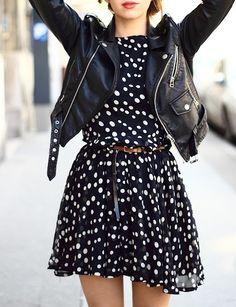 Leather jacket over girly polka dot dress