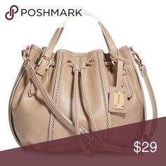 "mark. Avon Tan String Along Bucket Bag NWOT Get on trend with this new bucket bag! Color: Tan. Gold tone hardware. NWOT in poly bag!  • Faux leather (polyurethane).  • Magnetic snap closure with drawstring • 3 interior pockets (2 slip pockets at front; 1 zippered pocket at back)  • 14"" W x 12"" H x 5"" D (40"" L max. adjustable, detachable strap; 3"" handle drop at max.) Avon Bags Crossbody Bags"