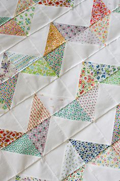 """What was once the vintage flying geese quilt has become the vintage zig-zag. I finished piecing the top this evening and I love it! Now I have to decide on backing. It's exactly 40"""" square, which is nice because it isn't too big. I am thinking about doing simple patchwork square for the backing. I want to use up some more of my vintage fabric stash!"""