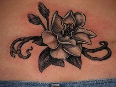 Black and grey Magnolia tattoo