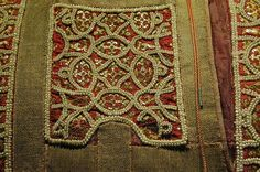 This is an example of a segmente or an embroidered patch apliqued to a garment worn during the Byzantine period. This segmente was found on the silk robe created in 1181 under King William II in Palermo. The Hohenstaufen dynasty later acquired it in 1194 where it remained as part of the treasures of the Normandy Kings. Segmente, like the one shown, were done in a tapestry weave in rich colors.