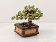 https://flic.kr/p/rAVwKm | Bonsai | Here's my newest ‪Lego project: an elegant, diminutive bonsai tree. Building guides for three breeds will be available next week at chrismcveigh.com! ‬