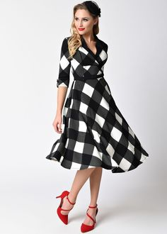 Hell's bells, Trudy knows no bounds! A plus size 1950s inspired frock in a bold black and white checkered print, the Trudy dress is crafted in an enduring stretch cotton blend with elegant black label collar and piping detail along the darted bodice for fabulous form and a luxurious, curve clutching fit. A sleek A-line plus size swing skirt with functional side pockets falls to knee length, while a stylish black buckle belt that can be adjusted to fit your silhouette. Zipping up the back to…