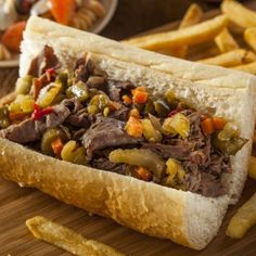 This super easy Italian beef sandwich is sure to change the way you use a crockpot. It's filling and can make for the perfect lunch. Hoagie Sandwiches, Italian Beef Sandwiches, Delicious Sandwiches, Italian Beef Recipes, Slow Cooker Italian Beef, Italian Foods, Chicago Beef, Slow Cooker Recipes, Cooking Recipes