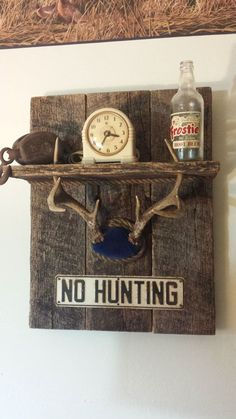 Whitetail deer antler shelf with No Hunting sign made with reclaimed rustic oak barn wood. Great addition to any hunters man cave décor by RusticCabinManCave