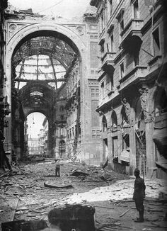 The Galleria Vittorio Emanuele II , in Milan, following the mid-August 1943 RAF bombing raids. 2,268 tons of bombs were dropped over three nights.