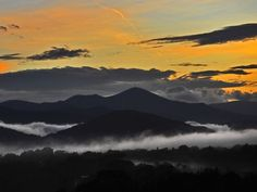 A clearing storm leaves clouds at sunset, in the French Broad River valley below Asheville's landmark Mt. Pisgah ... | photo by AC-T photographer Bill Sanders