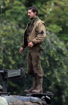Dapper: Despite the mud and battered combat gear, Brad and Shia looked suave on… Shia Lebouf, Shia Labeouf Fury, Brad Pitt, Fury 2014, 4th Infantry Division, Sherman Tank, Combat Gear, Cinema, War Film