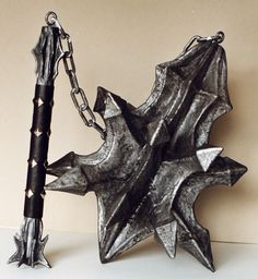 A replica of the mighty flail of the Witch-King of Angmar (Lord of the Rings: Return of the King). I used the same process as the helmet, but sculpted it from the lighter white styrofoam and the ha...