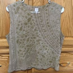 Tank top A pretty n stylish tank top. In good condition. The Material is stretchy. By the waist it's 19 1/2 inches wide n by the belly part it's 18 inches wide n 12 1/2 inches long Anne Klein Tops Tank Tops