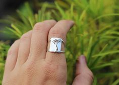 If you believe in the ocean breeze and palm trees, this ring is for you. Under the Palm Tree ring hand sawed for you, by Dreaming Tree Creations  (for you in the north, there may be a pine version coming up...)