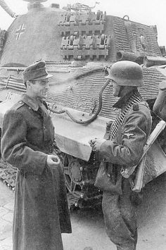 Here is a picture of a Hungarian soldier and his German ally, who is a machine gunner of the Totenkopf Division. They are standing next to a King Tiger tank in Budapest in early December, 1944.