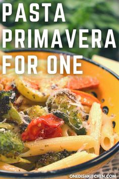 Easy Pasta Primavera recipe made with fresh seasonal vegetables which are roasted in the oven, then tossed with cooked pasta, butter and Parmesan cheese.
