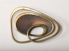 Art Smith | Brooch of brass and copper (round pin with enamel center) c. 1950s. USA.