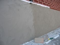 Parging - Applying a mortar coat with a trowel to control leakage in masonry walls, usually exposed basement or foundation walls. The mortar usually consists of one part portland cement to three parts sand.