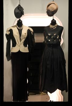 On the left wearing: Vivienne Westwood wool jacket, Dolce & Gabbana elastic dress, 1950s Bijoux Cascio necklace, 1980s cross-shaped brooch, 1950s rafia black hat with bow.  Outfit on the right: 1970s tailor-made linen top, 1990s taffeta skirt, 1970s Sarah Coventry necklaces, 1950s Gallia Peter Milano straw hat.