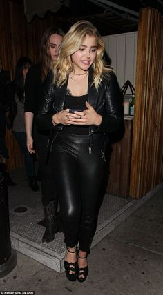 Simple style: The blonde beauty wore a few delicate necklaces around her neck, keeping her accessories to a minimal