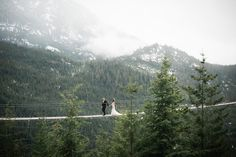 A wedding couple on the suspension bridge of the Sea To Sky Gondola in Squamish.