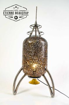 This retrofuturistic moodlamp is build from an old expansiontank. The pattern is handcut with a plasmacutter and shows mechanical parts. The lamp has a finishing touch with an old copper part of a ceilingcover of a chandelier.  Size :  H: 97cm x D: 40cm Details :  E27 socket Status :  FOR SALE Price (VAT incl) :  484 EUR  #rocket #space #scifi #plasmacutting #atompunk #steampunk #retrofuturism #lamp #moodlight Mood Light, Plasma Cutting, Lamp Ideas, Retro Futurism, Drawing S, Steampunk, Art Pieces, Sculptures, Copper
