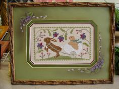 beautiful cross stitch Easter bunny framed by Rensel Studio