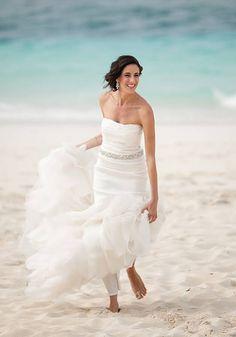 How to hem your beach wedding dress for both heals as bare feet.